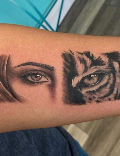 woman and tiger eye tattoo